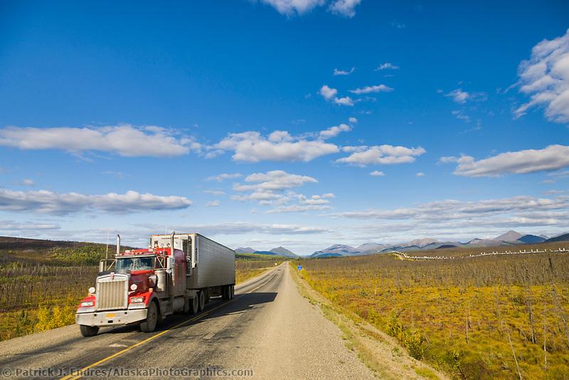 Semi tractor hauling supplies on the James Dalton Highway, Interior, Alaska.