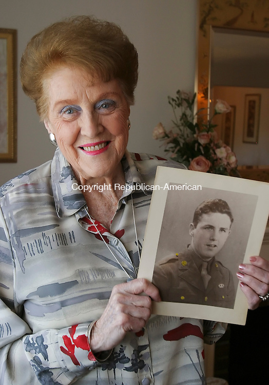 WATERBURY, CT 05/14/08- 051408BZ01- Jean Murphy, of Waterbury, holds a photograph of her brother Robert E. Doran who was killed in action on September 9, 1944, during Operation Market Garden in Holland during World War II.  Doran was a Ranger with the 101st Airborne Division and recipient of the Purple Heart and two Bronze Stars.<br /> Jamison C. Bazinet Republican-American