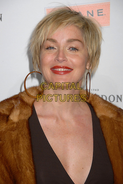 "SHARON STONE.""Scandinavian Style Mansion"" Party at a Private Residence in Bel Air, Los Angeles, California, USA, .1 December 2007..portrait headshot hoop earrings red lipstick.CAP/ADM/BP.©Byron Purvis/AdMedia/Capital Pictures."