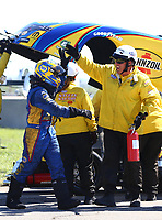 May 21, 2017; Topeka, KS, USA; NHRA funny car driver Ron Capps celebrates with a member of the Safety Safari after winning his fourth straight victory following the Heartland Nationals at Heartland Park Topeka. Mandatory Credit: Mark J. Rebilas-USA TODAY Sports