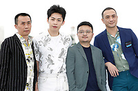 """(L-R) Actor Yongzhong Chen, actor Hong-Chi Lee, director Gan Bi and Jue Huang at the """"Long Day's Journey Into Night (Di Qui Zui Hou De Ye Wan)"""" photocall during the 71st Cannes Film Festival at the Palais des Festivals on May 16, 2018 in Cannes, France. Credit: John Rasimus / Media Punch ***FRANCE, SWEDEN, NORWAY, DENARK, FINLAND, USA, CZECH REPUBLIC, SOUTH AMERICA ONLY***"""