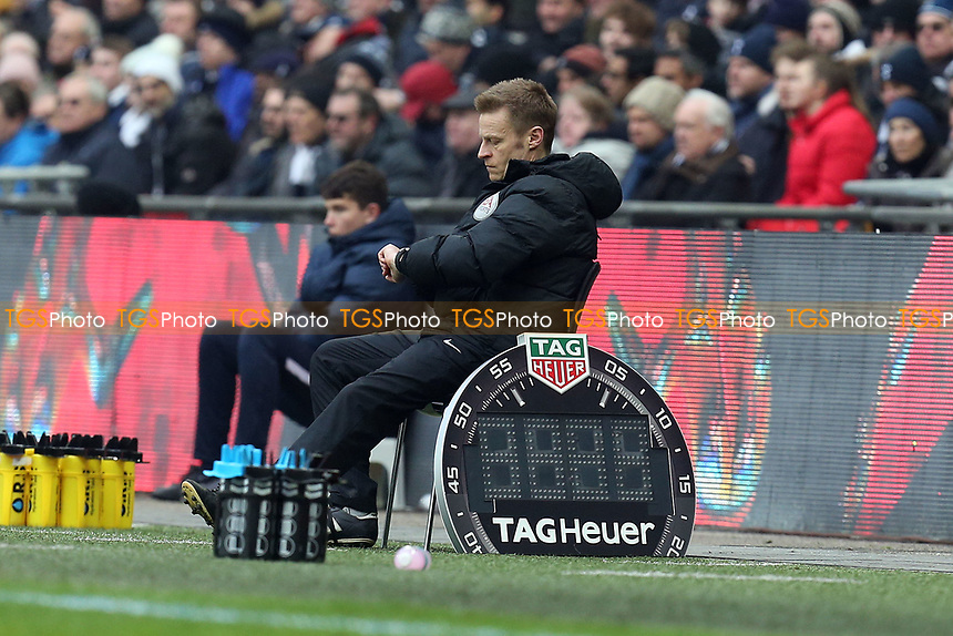 injured referee Michael Jones takes over as fourth official during Tottenham Hotspur vs Huddersfield Town, Premier League Football at Wembley Stadium on 3rd March 2018