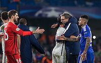 Paris Saint-Germain Manager (Coach) Laurent Blanc hugs captain Thiago Silva of Paris Saint-Germain on the final whistle as Kenedy of Chelsea & Goalkeeper Kevin Trapp of Paris Saint-Germain shake hands during the UEFA Champions League Round of 16 2nd leg match between Chelsea and PSG at Stamford Bridge, London, England on 9 March 2016. Photo by Andy Rowland.