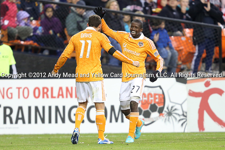 18 November 2012: Houston's Boniek Garcia (HON) (27) celebrates his goal with Brad Davis (11). DC United played the Houston Dynamo at RFK Stadium in Washington, DC in the second leg of their 2012 MLS Cup Playoffs Eastern Conference Final series. The game ended in a 1-1 tie, Houston won the series 4-2 on aggregate goals.
