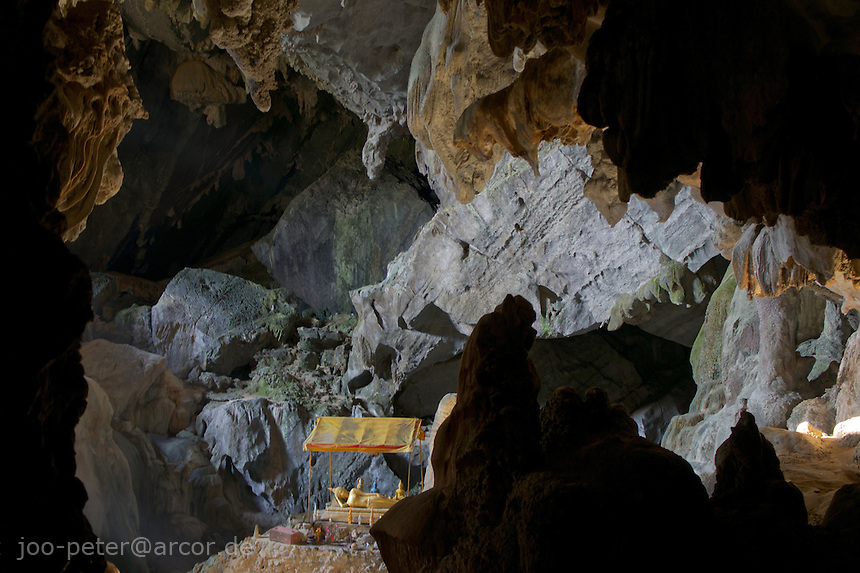 Buddha shrine in Poukham cave close to Vang Vieng, Laos, 2012. The cave is also spelled  Tham Pu Kham or Tham Pou Kham in latin  letter writing, meaning cave of the golden crab. Like in many caves of  Laos, there is a buddhist shrine inside.