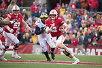 Wisconsin Badgers quarterack Alex Hornibrook (12) carries the ball during an NCAA College Big Ten Conference football game against the Michigan Wolverines Saturday, November 18, 2017, in Madison, Wis. The Badgers won 24-10. (Photo by David Stluka)