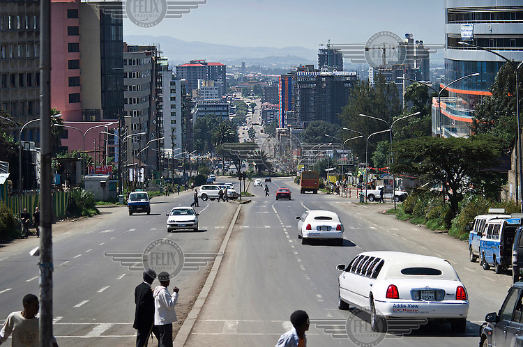 A view down a street with people and traffic in Addis Ababa.