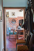 In the kitchen warm red terracotta floor tiles complement the exposed brickwork of the walls