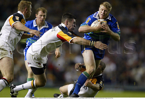DARREN ALBERT is tackled by Mike Forshaw & Michael Withers, Bradford Bulls 18 v ST HELENS 19, Tetley's Superleague Grand Final, Old Trafford 021019 Photo:Neil Tingle/Action Plus...2002.rugby league.tackles