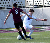 Westside Eagle Observer/MIKE ECKELS<br /> <br /> Christian Flores (Wolverine 8) and Seth Rich (Bulldogs 2) go toe-to-toe for control of the ball during the first half of the Siloam Springs-Decatur soccer match at Panther Stadium in Siloam Springs March 12. The Panthers took the non-conference victory 6-0 over the Bulldogs.