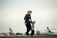 Photography of the Runway 5K at Charlotte Douglas International Airport. Hundreds of people braved the cold temperatures for the unique opportunity to run on one of the countries busiest airport runways in Charlotte, North Carolina.<br /> <br /> Charlotte Photographer - PatrickSchneiderPhoto.com
