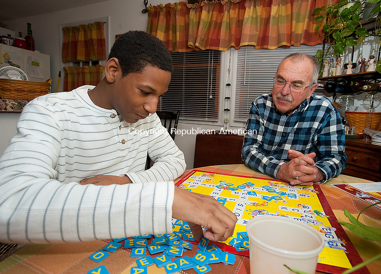 WATERBURY, CT 14 FEBRUARY 2013-021413JS09--Javier Diaz, 14, plays Scrabble with his Big Brother Tom Cigas, right, a retired school teacher, on Thursday. .Jim Shannon Republican-American
