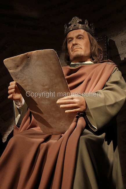 Model of King Alfonso X the Wise of Castile, 1221-84, holding a parchment, from the Museo Vivo de Al-Andalus in the Torre Calahorra, Cordoba, Andalusia, Southern Spain. The historic centre of Cordoba is listed as a UNESCO World Heritage Site. Picture by Manuel Cohen