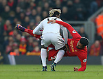 Didier Ndong of Sunderland tussles with Emre Can of Liverpool during the Premier League match at the Anfield Stadium, Liverpool. Picture date: November 26th, 2016. Pic Simon Bellis/Sportimage