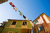Clothing hangs to dry between buildings, Camogli, Liguria, Italy