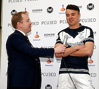 Mark Ramsdale (L) interviews the Oxford captain James Clark during the 2016 Pcubed Rugby League Varsity game between Oxford University and Cambridge University at the HAC ground, London, on Fri March 4, 2016