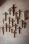 Crucifixes on wall for sale in the gift shop at  Mission San Juan Baptista, Calif.