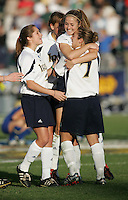 05 December,  2004.  Notre Dame's Annie Schefter is congratulated on making her penalty kick by teammate Katie Thorlakson (7) during the NCAA finals at SAS Stadium in Cary, NC.