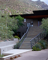 The exterior of the building is stucco and stone and is approached by a steep set of steps