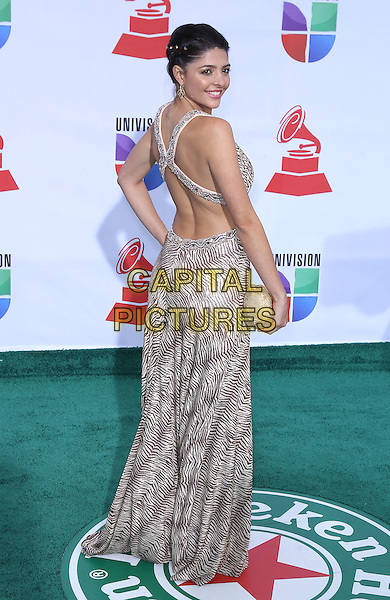 Catalina Mesa.2011 Latin Grammy Awards Arrivals at Mandalay Bay Resort Hotel and Casino. Las Vegas, Nevada, USA..10th November 2011.full length white black print dress looking over shoulder.CAP/ADM/MJT.© MJT/AdMedia/Capital Pictures.
