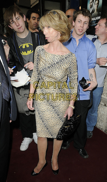 HELEN WORTH.'Pygmalion' Press Night at the Garrick Theatre, London, England..May 25th 2011.full length beige brown leopard print dress profile .CAP/CAN.©Can Nguyen/Capital Pictures.