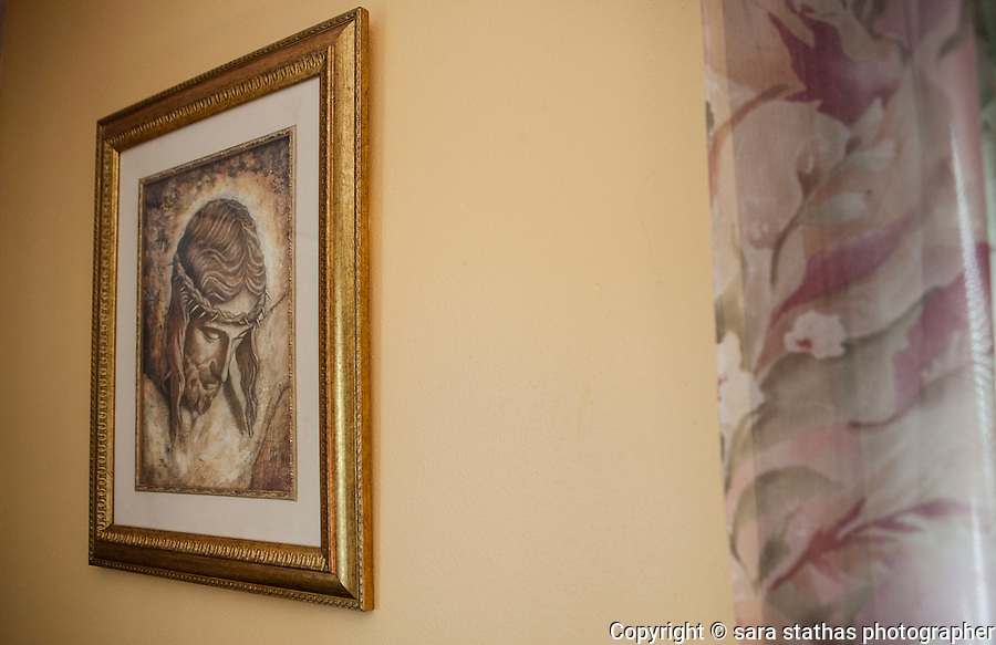 Religious art work hangs in the dining room of Todd and Melissa Puchalla's Kiel, Wisconsin home.  Melissa and her husband Todd rehomed their adopted daughter, Quita, when she was 15 years old.  REUTERS/Sara Stathas (UNITED STATES)