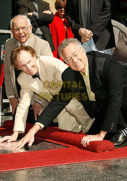 "ROBBY KREIGER & RAY MANZAREK OF ""THE DOORS"".The Doors Celebrate 40th Anniversary with  a Star on the Hollywood Walk of Fame, Hollywood, California , USA,.28 February  2007 .half length hands.CAP/ADM/RE.©Russ Elliot/AdMedia/Capital Pictures. *** Local Caption *** ."