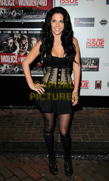 "BIANCA GASCOIGNE .Attending the ""Malice In Wonderland"" UK Film Premiere, Prince Charles Cinema, Leicester Square, London, England, UK,.February 4th 2010..arrivals full length black corset bustier dress tights peep toe ankle boots lace-up booties hand on hip shooboots waist cincher.CAP/CAN.©Can Nguyen/Capital Pictures."