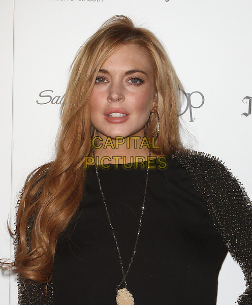 "Lindsay Lohan.Star Magazine's ""All Hollywood"" Event With Performance By Karmin Held at AV Nightclub, Hollywood, California, USA..April 24th, 2012.headshot portrait black dress gold beads beaded sleeves spiked necklace.CAP/ADM/KB.©Kevan Brooks/AdMedia/Capital Pictures."
