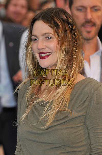 DREW BARRYMORE .Attending the World Premiere of 'Going The Distance' at Vue West End cinema, Leicester Square, London, England, UK,.August 19th 2010.portrait headshot green khaki red lipstick make-up hair braid plait messy  smiling .CAP/PL.©Phil Loftus/Capital Pictures.