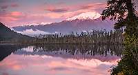 Sunset at Lake Wahapo near Whataroa with kahikatea grove and Mt. Adams in background, Westland National Park, West Coast, World Heritage Area, New Zealand