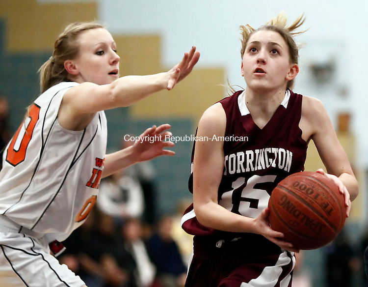 Waterbury, CT-  February 2013-022113CM12-  Torrington's  Caroline Teti drives to the hoop against Watertown's Danielle Lutkus  during the NVL finals in Waterbury Thursday night.   Torrington won, 40-38 after a late 4th quarter bucket by Megan Calabrese.   Christopher Massa Republican-American