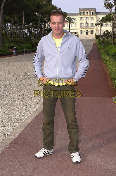EWAN McGREGOR.at Hotel du Cap, Cap d'Antibes.Cannes Film Festival, France,.May 13th 2001..full length blue zip up top yellow t shirt casual.Ref: PL.www.capitalpictures.com.sales@capitalpictures.com.©Capital Pictures.