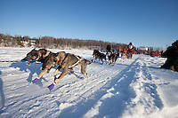 Jenny Greger leaves the start line of the Junior Iditarod  at Knik Lake, Knik, Alaska