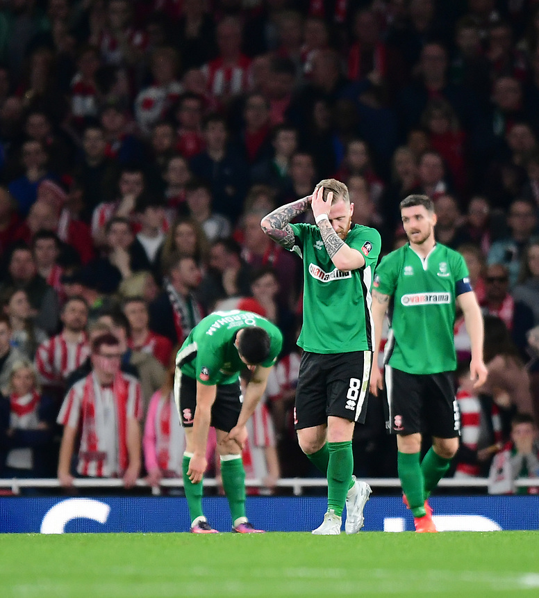 Lincoln City players, from left, Sam Habergham, Alan Power and Luke Waterfall react after Arsenal's Theo Walcott scored the opening goal <br /> <br /> Photographer Chris Vaughan/CameraSport<br /> <br /> The Emirates FA Cup Quarter-Final - Arsenal v Lincoln City - Saturday 11th March 2017 - The Emirates - London<br />  <br /> World Copyright &copy; 2017 CameraSport. All rights reserved. 43 Linden Ave. Countesthorpe. Leicester. England. LE8 5PG - Tel: +44 (0) 116 277 4147 - admin@camerasport.com - www.camerasport.com