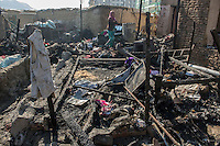 Aftermath of fire at Chamne Babrak refugee camp. 31-12-13