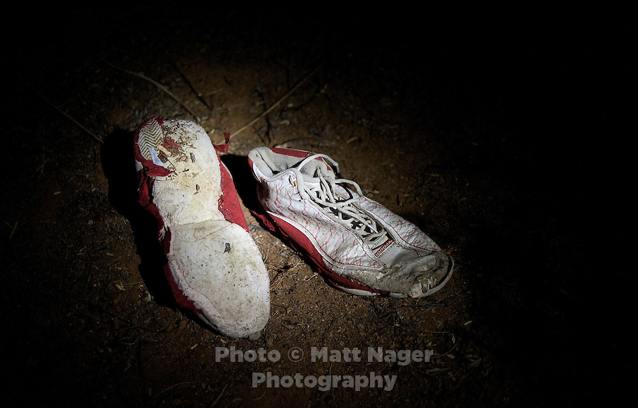 A lost pairs of shoes rest on a migrant trail near Interstate 19 north of Nogales, AZ, August 3, 2009. The soles of shoes are often ripped off in order to avoid leaving prints which Border Patrol agents use to track and capture migrants crossing the desert illegally...PHOTOS/ MATT NAGER