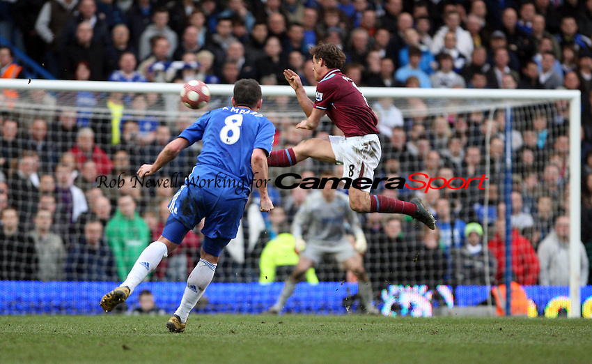 Frank Lampard of Chelsea tries his luck from long range - Chelsea vs West Ham United, Barclays Premier League at Stamford Bridge, Chelsea - 13/03/10 - MANDATORY CREDIT: Rob Newell/TGSPHOTO - Self billing applies where appropriate - 0845 094 6026 - contact@tgsphoto.co.uk - NO UNPAID USE.