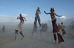 Stilt walkers enjoy a sunset stroll at the Burningman counter culture arts festival in the Black Rock Desert 100 miles north east of Reno, NV, Thursday, Sept 2, 2004.