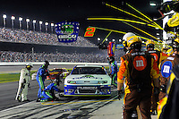 Casey Mears (#13) makes a pit stop.