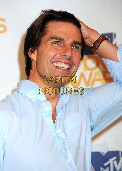 TOM CRUISE .MTV Movie Awards 2010 - Press Room held at the Gibson Amphitheatre, Universal City, California, USA..June 6th, 2010.headshot portrait smiling hand ring blue shirt  look closer sweat patch.CAP/ADM/BP.©Byron Purvis/AdMedia/Capital Pictures.