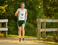 Photography of the Woodlawn School Varsity Cross Country team running Saturday morning  September 19, 2015, during the Annual Hare &amp; Hounds Invitational race at McAlpine Greenway Park in Charlotte, NC<br /> <br /> Charlotte Photographer - PatrickSchneiderPhoto.com