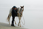 Horse and woman on the beach in Crescent City California