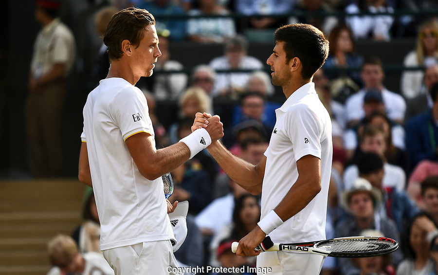 Novak Djokovic (SRB) retires and shakes the hand of Tomas Berdych (CZE)