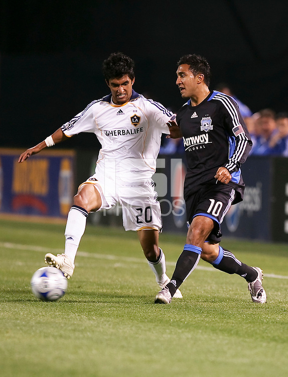 A.J. DeLaGarza (20) and Arturo Alvarez (10) battle for the ball. San Jose Earthquakes tied Los Angeles Galaxy 1-1 at the McAfee Colisum in Oakland, California on April 18, 2009.