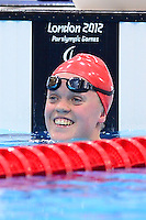 PICTURE BY ALEX BROADWAY /SWPIX.COM - 2012 London Paralympic Games - Day Ten - Swimming, Aquatic Centre, Olympic Park, London, England - 08/09/12 - Eleanor Simmonds of Great Britain reacts after the Women's 100m Freestyle S6 Final.