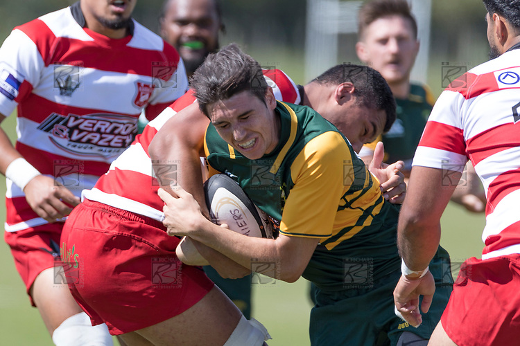Trent White gets tackled by Seluini Molia. Counties Manukau Premier Counties Power Club Rugby game between Karaka and Pukekohe, played at the Karaka Sports Park on Saturday March 10th 2018. Pukekohe won the game 31 - 27 after trailing 5 - 20 at halftime.<br /> Photo by Richard Spranger.