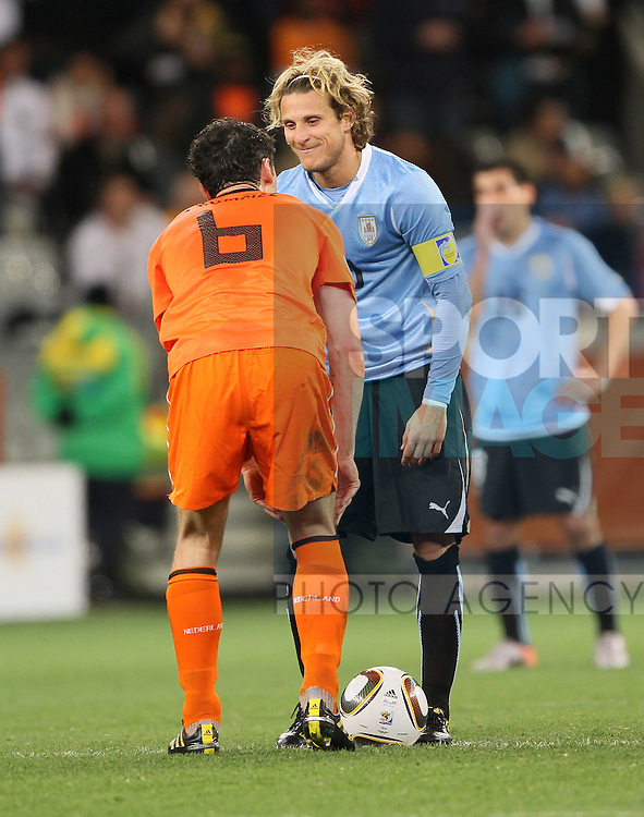 Uruguay's Diego Forlan has words with Netherland's Mark Van Bommel as his side goes 2-1 down
