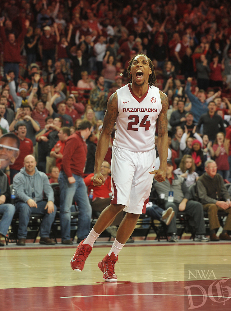 NWA Democrat-Gazette/Michael Woods --01/06/2015--w@NWAMICHAELW... University of Arkansas guard Michael Qualls celebrates after a slam dunk on a fast break during the overtime period of the Razorbacks 93-91 overtime victory over Alabama during Thursday nights game at Bud Walton Arena in Fayetteville.
