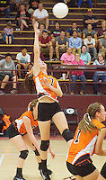 Photo by Randy Moll<br /> Misa Satchel, Gravette junior, spikes the ball across the net for Gravette during play against the Lady Pioneers at Gentry High School on Tuesday, Sept. 22, 2015.